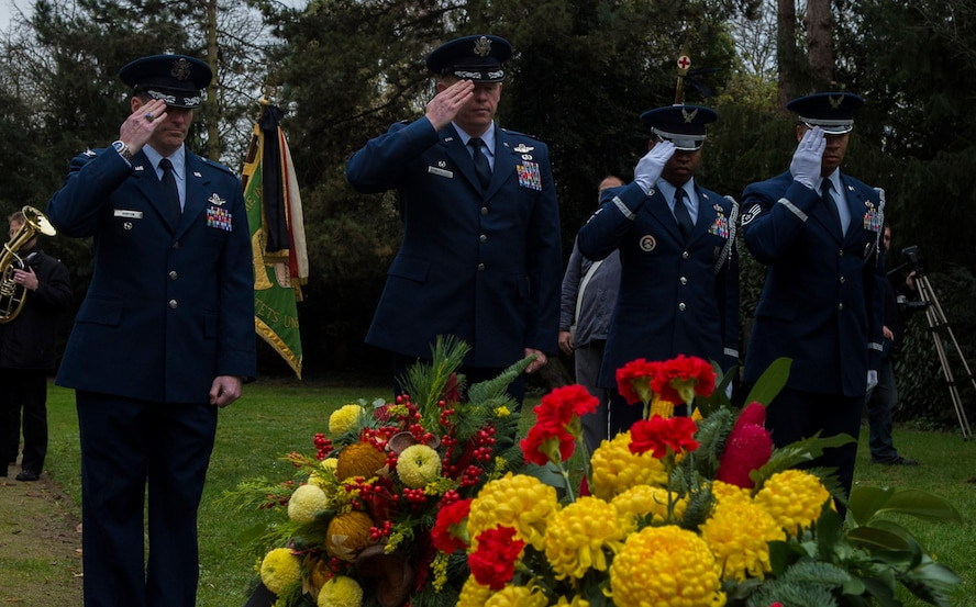 Spangdahlem Airmen salute after laying a wreath during a National Mourning Day ceremony at a cemetery in Trier, Germany, Nov. 15, 2015. Germany's National Mourning Day is day for mourning the victims of the two world wars, those who lost their lives during current operations, and ones still missing in action. (U.S. Air Force photo by Airman 1st Class Luke Kitterman/Released)