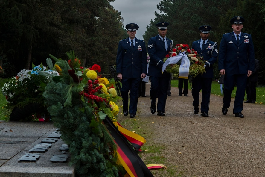 Spangdahlem Airmen prepare to lay a wreath during a National Mourning Day ceremony at a cemetery in Trier, Germany, Nov. 15, 2015. Germany's National Mourning Day is day for mourning the victims of the two world wars, those who lost their lives during current operations, and ones still missing in action. (U.S. Air Force photo by Airman 1st Class Luke Kitterman/Released)