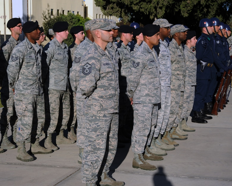 U.S. and Turkish Airmen stand at parade rest during a Veterans Day ceremony Nov. 11, 2015, at Incirlik Air Base, Turkey. Veterans Day is a U.S. federal holiday to honor military veterans who have served in the U.S. Armed Forces. (U.S. Air Force photo by Airman 1st Class Daniel Lile/Released)