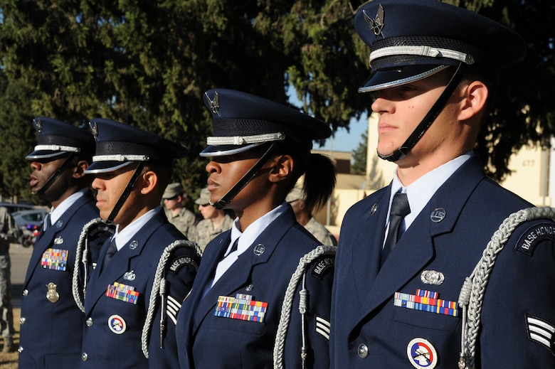 Members of the 39th Air Base Wing Honor Guard stand at attention during a Veterans Day ceremony Nov. 11, 2015, at Incirlik Air Base, Turkey. The ceremony included the playing of taps and closing remarks by Col. John Walker, 39th ABW commander, to pay respect for all veterans who have served past, present and future. (U.S. Air Force photo by Airman 1st Class Daniel Lile/Released)