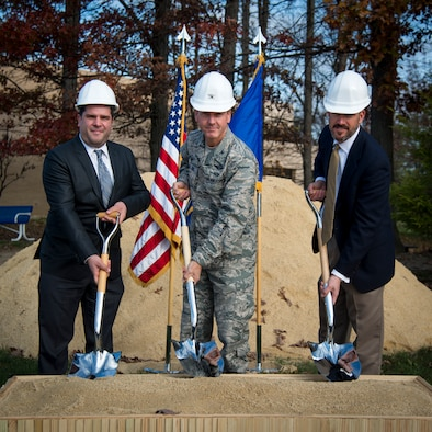 From left, Tony Pares, Army and Air Force Exchange Service Base Exchange general manager, Col. Brad Hoagland, 11th Wing and Joint Base Andrews commander, and Erick Kallas, Baggette Construction vice president, commemorate the start of the BX's expansion and renovation with a ground breaking ceremony at Joint Base Andrews, Md., Nov. 17, 2015. The new facility is expected to be finished by fall 2017. (U.S. Air Force photo/Airman 1st Class Philip Bryant)