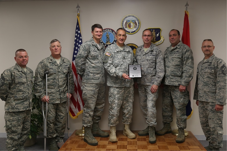 Maj. Gen. Steve Danner, the adjutant general of the Missouri National Guard, presented an award for achieving and maintaining 100 percent end strength for fiscal year 2014 to the commanders, command chiefs and representatives of the 131st Bomb Wing and the 139th Airlift Wing, Nov. 6, 2015 at the Missouri National Guard Headquarters in Jefferson City, Mo. (U.S. Army National Guard photo by Sgt. Mariah Best)