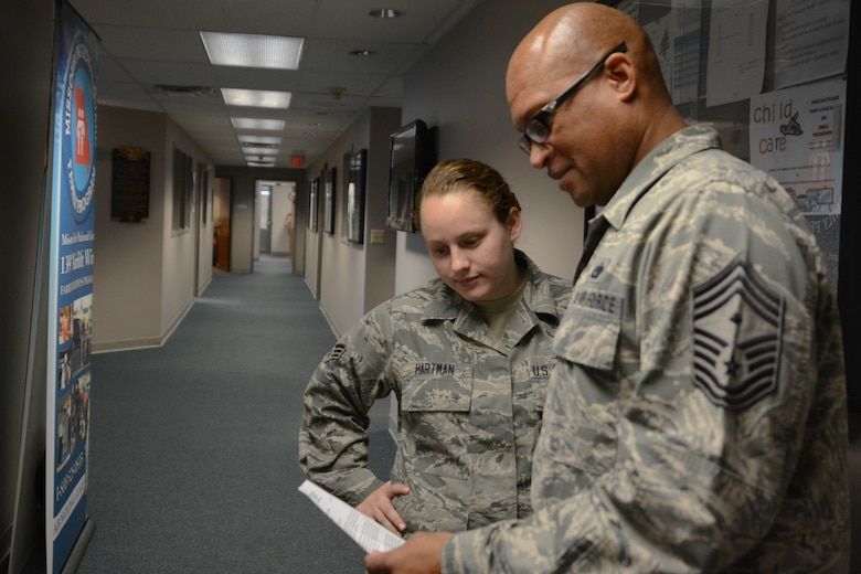 Chief Master Sgt. Joseph Hamlett, first seargent assigned to the 139th Airlif Wing, discusses the key factors in leadership with an airman at Rosecrans Air National Guard Base on Nov. 17, 2015. (U.S. Air National Guard photo by Senior Airman Bruce Jenkins)