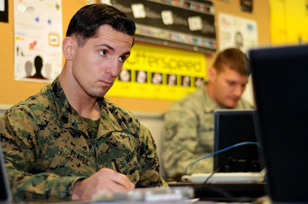 Marine Sgt. Marcin J. Platek, an instructor at the Defense Information School at Fort Meade, Md., attends a Broadcast Management Course class at DINFOS on Nov. 9, 2015. In preparation for teaching the course, he is taking it for credit.