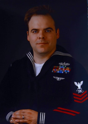 This official photo of Stephen Woolverton, now a civilian instructor at the Defense Information School at Fort Meade, Md., was taken approximately five years ago while he was on active duty.