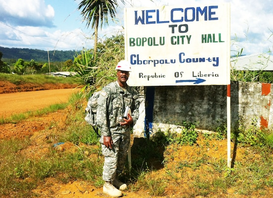 New York District civil engineer Milton Ricks outside a government office in northern Liberia (West Africa) during a nine-month deployment helping contain the Ebola virus. The Forward Engineer Support Team - Advanced (FEST-A) was tasked to perform a site survey for possible construction of an Ebola center facility nearby.
