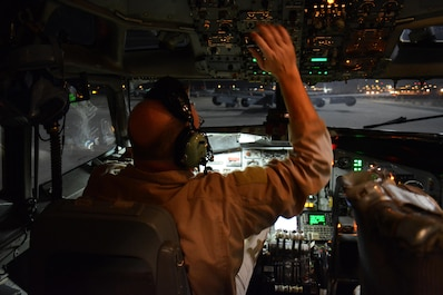 Master Sgt. Curtis Stark, 7th Expeditionary Air Combat Control Squadron superintendent, conducts a pre-flight inspection in the cockpit of an E-8C Joint Surveillance Target Attack Radar System aircraft at Al Udeid Air Base, Qatar Nov. 14. Stark has deployed 17 times with JSTAR aircraft in support of contingency operations and has accumulated more than 4,000 combat flying hours. After nearly 30 years of service he plans to retire from the Air Force in March 2016. (U.S. Air Force photo by Tech. Sgt. James Hodgman/Released)
