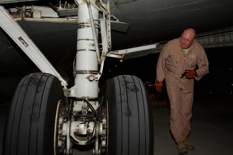 Master Sgt. Curtis Stark, 7th Expeditionary Air Combat Control Squadron superintendent, conducts a pre-flight inspection on the exterior of an E-8C Joint Surveillance Target Attack Radar System aircraft at Al Udeid Air Base, Qatar Nov. 14. Stark has deployed 17 times with JSTAR aircraft in support of contingency operations and has accumulated more than 4,000 combat flying hours. After nearly 30 years of service he plans to retire from the Air Force in March 2016. (U.S. Air Force photo by Tech. Sgt. James Hodgman/Released)