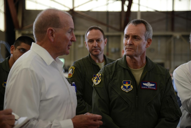 James Kelly, 47th Maintenance Directorate director of Maintenance, speaks to Lt. Gen. Darryl Roberson, commander of Air Education and Training Command, during the general's tour of Laughlin Air Force Base, Texas, Nov. 16, 2015. While at Laughlin, Roberson toured the T-6A Texan II aircraft hangar to discuss and observe maintenance operations. (U.S. Air Force photo by Airman 1st Class Ariel D. Partlow)