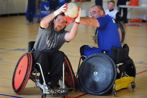 A player representing U.S. Special Operations Command hustles for possession against an Air Force player during tournament play Nov. 16, 2015, at Joint Base Andrews, Md. Wounded warriors from all branches of the armed forces participated in the Warrior CARE Month's Joint Services Wheelchair Rugby Exhibition. (Defense Department photo/Marvin Lynchard)
