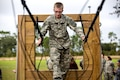 An Army Junior Officer Training Corps cadet navigates a three-rope bridge on Eglin Air Force Base, Fla., Nov. 10, 2015. U.S. Army photo by Pfc. David Stewart