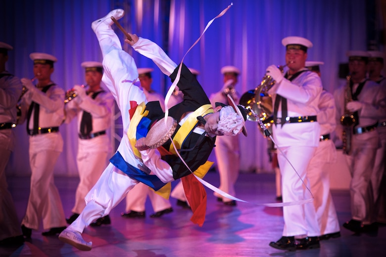 A South Korean navy band performer dances during the Japan Self-Defense Force Marching Festival at the Nippon Budokan Arena in Tokyo, Nov. 13, 2015. The festival allowed all of the bands the opportunity to engage and interact with one another. (U.S. Air Force photo/Airman 1st Class Delano Scott)