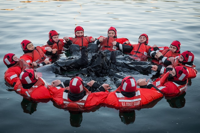 Coast Guardsmen test their survival suits for leaks in Boston Harbor, Nov. 18, 2015. The Coast Guardsmen, assigned to the Coast Guard Cutter Spencer, were preparing for winter as temperatures dropped throughout New England. U.S. Coast Guard photo by Petty Officer 3rd Class Ross Ruddell