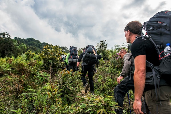 Members from the Defense POW/MIA Accounting Agency (DPAA), hike up to explore the suspected area of a B-24J airplane crash in Arunachal Pradesh, India and begin the search and recovery efforts to retrieve eight US Army Air Corps members that went down with the aircraft in 1942. DPAA conducts global search, recovery and laboratory operations to identify unaccounted-for Americans from past conflicts in order to support the Department of Defense's personnel accounting efforts. (DoD photo by SSgt Erik Cardenas/U.S. Air Force)