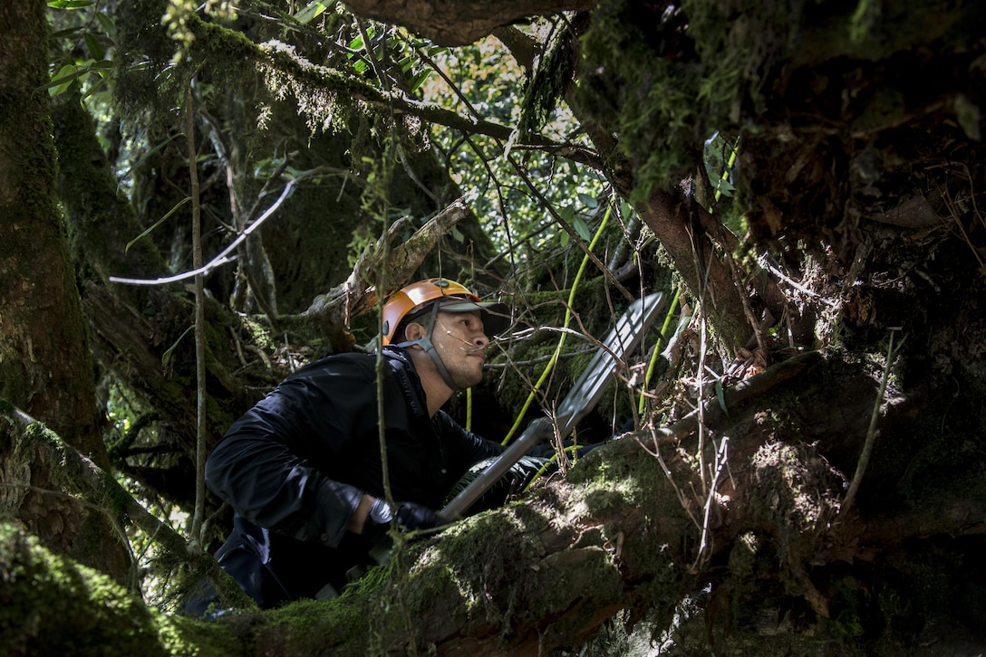 US Marine Corps Staff Sgt. Bobby Perez, Defense POW/MIA Accounting Agency (DPAA), sweeps for metal in the suspected area of a B-24J airplane crash in Arunachal Pradesh, India during the search and recovery efforts to retrieve eight US Army Air Corps members that went down with the aircraft in 1942. DPAA conducts global search, recovery and laboratory operations to identify unaccounted-for Americans from past conflicts in order to support the Department of Defense's personnel accounting efforts. (DoD photo by SSgt Erik Cardenas/U.S. Air Force)