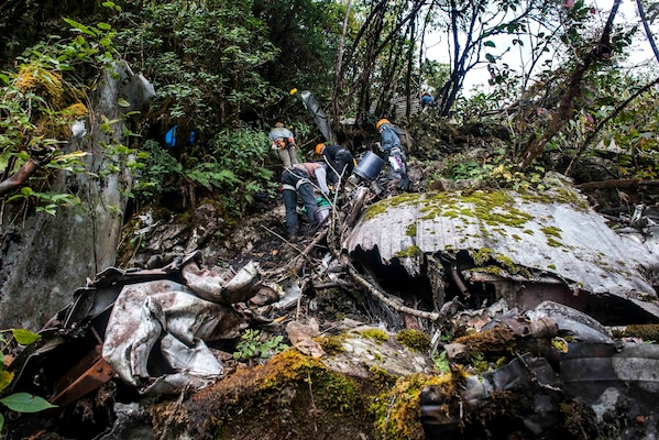 Members from the Defense POW/MIA Accounting Agency (DPAA), hike up to explore the suspected area of a B-24J airplane crash in Arunachal Pradesh, India and began the search and recovery efforts to retrieve eight US Army Air Corps members that went down with the aircraft in 1942. DPAA conducts global search, recovery and laboratory operations to identify unaccounted-for Americans from past conflicts in order to support the Department of Defense's personnel accounting efforts. (DoD photo by SSgt Erik Cardenas/U.S. Air Force)