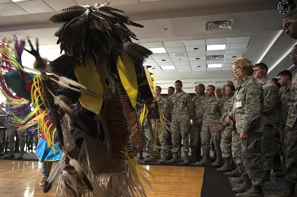 A Native American dancer shuffles across the dance floor in front of a group of Airmen for Native American Heritage Month at the Event Center on Goodfellow Air Force Base, Texas, Nov. 17, 2015. The dancer's garb was supposed to mimic an animal in nature for the dance. (U.S. Air Force photo by Airman 1st Class Caelynn Ferguson/Released)