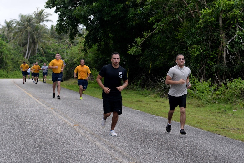 Service members and families run in the Turkey Trot 5K Nov. 18, 2015, at Andersen Air Force Base, Guam. More than 200 runners took to the road to celebrate Thanksgiving during the event sponsored by the 36th Force Support Squadron. (U.S. Air Force photo by Airman 1st Class Alexa Ann Henderson/Released)