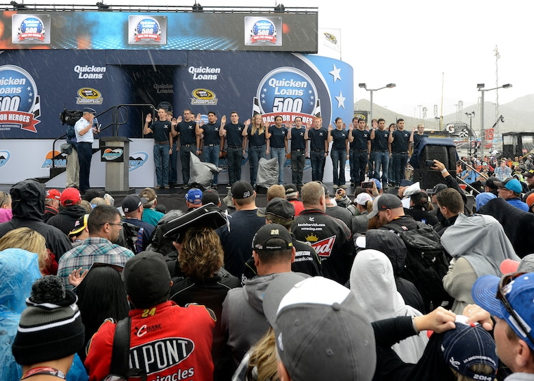 Lt. Gen. Mark Nowland, 12th Air Force commander, delivers an oath of enlistment to 25 Air Force delayed entry program members prior to the start of the Quicken Loans Race for Heroes 500 at the Phoenix International Raceway, Ariz., Nov.15, 2015. (U.S. Air Force photo by Senior Airman Devante Williams)