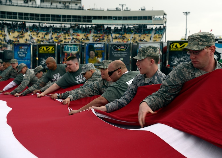 Luke Air Force Base airmen fold the National Flag during the Quicken Loans Race for Heroes 500 at the Phoenix International Raceway, Ariz., Nov. 15, 2015. Veterans, active military members and their families were front and center for the race as NASCAR honor their service and sacrifice for the nation. (U.S. Air Force photo by Senior Airman Devante Williams)