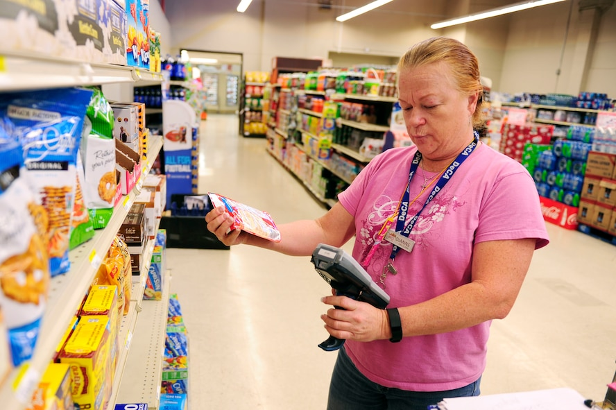 Retired Air Force Tech. Sgt. Dianne Welch, Vandenberg Commissary computer assisted operator, scans the inventory Nov. 18, 2015, Vandenberg Air Force Base, Calif. Welch retired at Vandenberg  as aircrew life support and continued to serve in the commissary. (U.S. Air Force photo by Staff Sgt. Jim Araos)