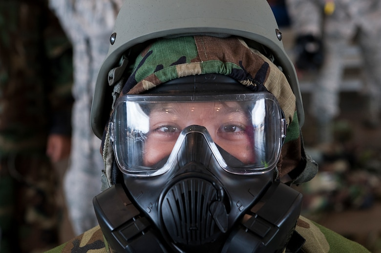 A child tries on a gas mask and mission oriented protective posture (MOPP) gear at Skoshi Warrior Nov. 14, 2015, at Kadena Air Base, Japan. Skoshi Warrior is an annual event designed to help children understand some of the deplyment processes that their military parents go through. (U.S. Air Force photo by Airman 1st Class Corey M. Pettis)