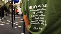 A participant wears the event shirt of the MacDonald Hero Workout event at Iron Empire gym in Dover, New Hampshire, Nov. 10, 2015. Iron Empire hosted a community workout in honor Lance Cpl. MacDonald, a Marine who lost his life in Iraq in 2003, or whomever the participants individually wanted to honor.