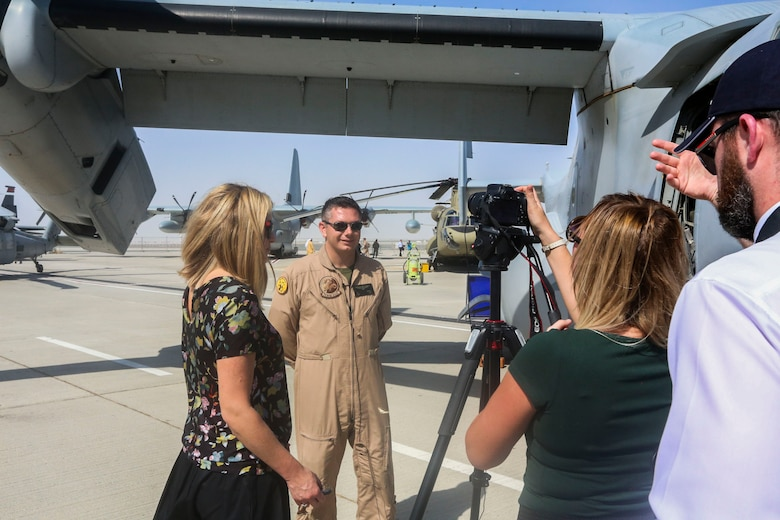 Capt. John Campbell, a pilot and a weapons and tactics instructor with the Red Dragons of Marine Medium Tiltrotor Squadron 268, Aviation Combat Element of Special Purpose Marine Air-Ground Task Force Crisis Response Central Command 16.1., conducts a media interview during 2015 Dubai Air Show, Dubai World Central, United Arab Emirates from November 8 - 12.