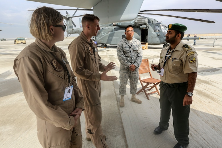 From left to right: Staff Sgt. Kristie Ness, a crew chief  and Sgt. Dan Leneghan, a maintenance controller, with the Red Dragons of Marine Medium Tiltrotor Squadron 268, Aviation Combat Element, Special Purpose Marine Air-Ground Task Force Crisis Response Central Command 16.1 showcased some of the unit's aviation capabilities to thousands of foreign military personnel and distinguished visitors at the 2015 Dubai Air Show, Dubai World Central, United Arab Emirates from November 8 - 12.