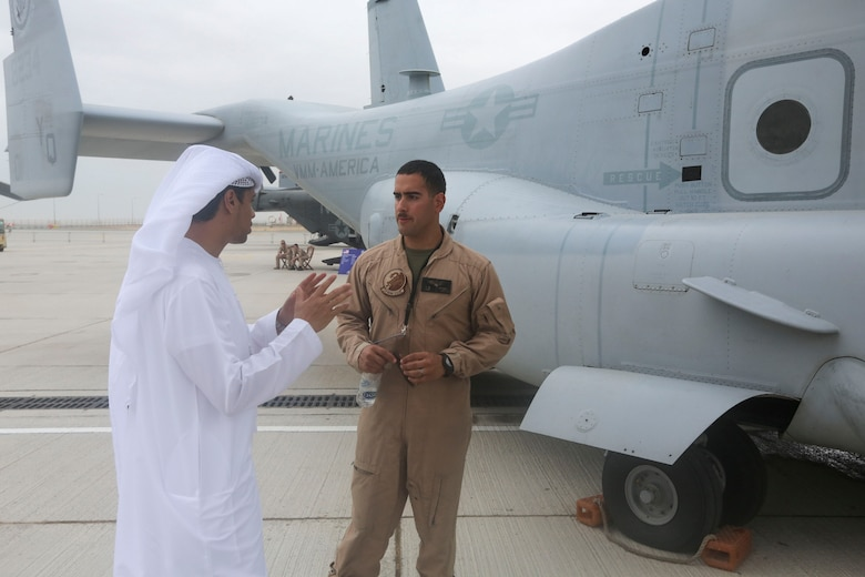 1st. Lt. Manuel Torres, a pilot with with the Red Dragons of Marine Medium Tiltrotor Squadron 268, Aviation Combat Element, Special Purpose Marine Air-Ground Task Force Crisis Response Central Command 16.1  reviews some of the unit's aviation capabilities to one of the thousands of visitors at the 2015 Dubai Air Show, Dubai World Central, United Arab Emirates from November 8 - 12.