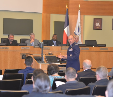 Col. David Drichta, 12th Operations Group commander, thanks the city of Schertz for the community's support of formal adoption of the Joint Land Use Study during a city council meeting in Schertz, Texas, Nov. 17, 2015.  The study, a joint effort between the military and surrounding community partners focused on finding solutions in mutual areas of concern, such as incompatible development around airfields, was adopted by a 5-0 vote. (U.S. Air Force photo/Randy Martin)