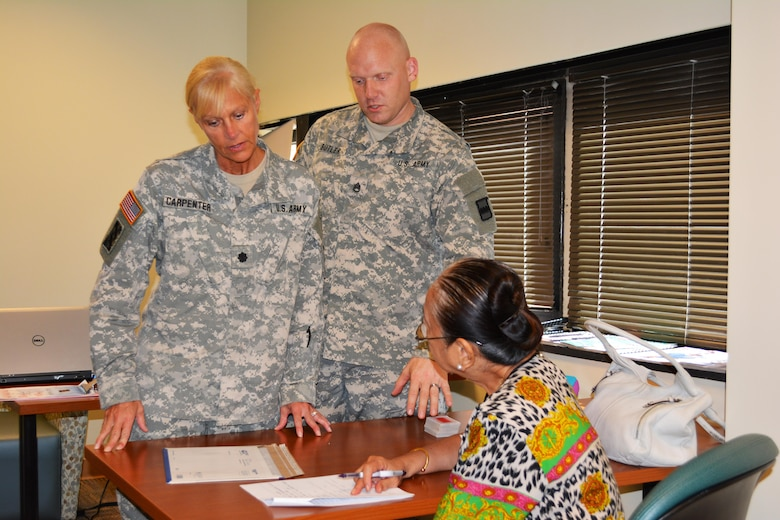 Lt. Col. Phyllis Carpenter, deputy 80th Training Command Staff Judge Advocate, and Sgt. 1st Class Sven Butler, paralegal 80th TC, provide legal advice the spouse of a veteran at Hunter Holmes McGuire VA Medical Center, Richmond, Va. Staff members of the 80th TC Office of the SJA volunteer their services once a month at the medical center helping Wounded Warriors and veterans who qualify for legal benefits.