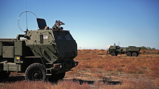 Marines assigned to Battery Q, 5th Battalion, 11th Marine Regiment, 1st Marine Division, stand ready to employ the High Mobility Artillery Rocket System during the 5/11 Command Post Exercise aboard Marine Corps Base Camp Pendleton, Calif., Nov. 18, 2015. The CPX provided an opportunity for the Marines to refresh their skillsets in preparation for exercise Steel Knight 2016.