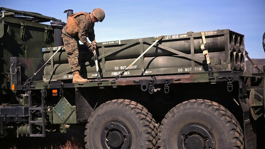 A Marine with Battery Q, 5th Battalion, 11th Marine Regiment, 1st Marine Division, checks the straps to secure a rocket pod for a High Mobility Artillery Rocket System during the 5/11 Command Post Exercise aboard Marine Corps Base Camp Pendleton, Calif., Nov. 18, 2015. The CPX provided an opportunity for the Marines to refresh their skillsets in preparation for exercise Steel Knight 2016.