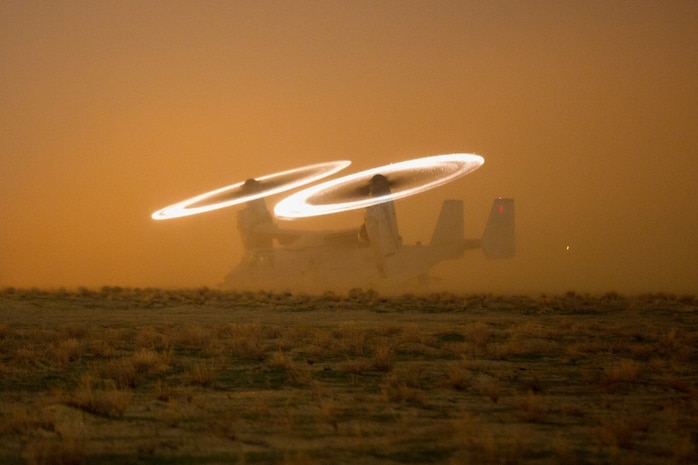A U.S. Marine Corps MV-22 Osprey assigned to Special Purpose Marine Air-Ground Task Force-Crisis Response-Central Command (SPMAGTF-CR-CC) stages on a hasty landing zone during a tactical recovery of aircraft and personnel (TRAP) drill at an undisclosed location in Southwest Asia, Nov. 16, 2015. SPMAGTF-CR-CC is ready to respond to any crisis response mission in theatre to include the employment of a TRAP force. (U.S. Marine Corps photo by Lance Cpl. Clarence Leake/Released)