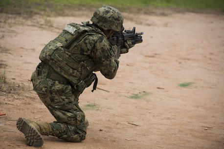 A Mexican Marine engage targets with his M-16 service rifle alongside partner nations during UNITAS Amphibious 2015 at Ilha do Governador, Brazil, Nov. 17, 2015. Exercises like UNITAS Amphib bring together countries in the Western Hemisphere to exchange knowledge and tactics. This allows us to build more effective partnerships so we are ready to respond to any emergency. (Photo taken by U.S. Marine Lance Cpl. Ricardo Davila/Released)