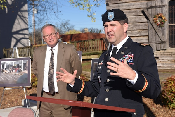 Lt. Col. Stephen Murphy (Right), U.S. Army Corps of Engineers Nashville District commander, speaks in Lebanon Square Nov. 19, 2015 during a signing ceremony for a Flood Risk Management Study of Bartons Creek as Mayor Philip Craighead, Lebanon, Tenn., listens to the colonel.