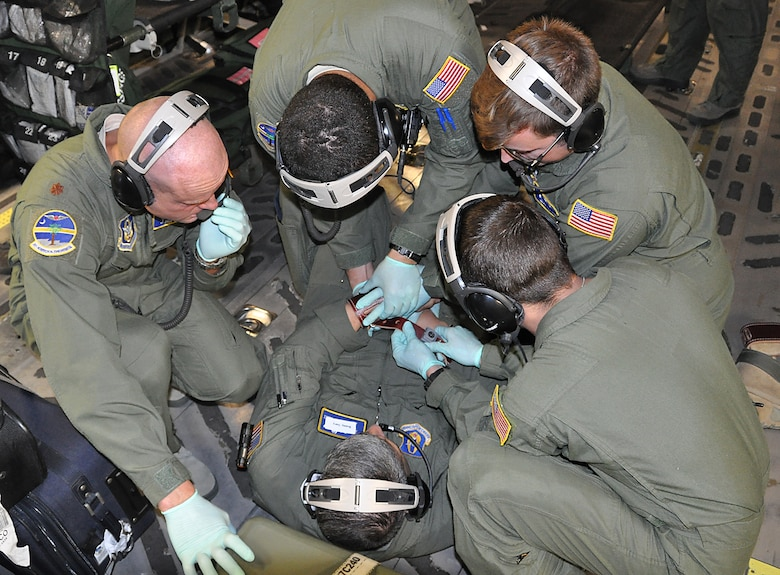 During an off station exercise for the 315th Aeromedical Evacuation Squadron. Master Sgt. Johnny Gomez played the part of a Soldier returning to Afghanistan after multiple deployments. This scenario was to gauge how the AE members would react when the Soldier had an anxiety attack midair and eventually became combative. The patient was successfully restrained to keep him from harming himself or others on the jet. (U.S. Air Force Photo by 2nd Lt. Chris Long)