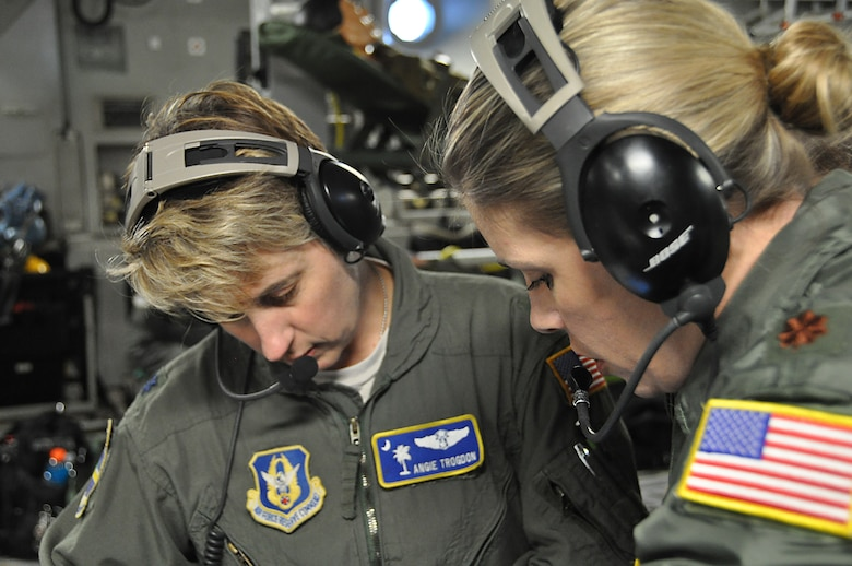 Lt Col Angie Trogdon, 315th Aeromedical Evacuation Squadron flight nurse and  officer in charge of operations, and Major Roseann Teckman, 315th AES examiner and Standardization and Evaluation team member, discuss task requirements for currency and check ride training during an off station exercise for the Aeromedical Evacuation Squadron in November.  (U.S. Air Force Photo by 2nd Lt. Chris Long)