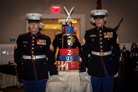Marines with Recruiting Station Portsmouth, New Hampshire, escort the birthday cake to the head table during the station's 240th Marine Corps Birthday Ball held at the Portsmouth Harbor Events Center, Nov. 13.