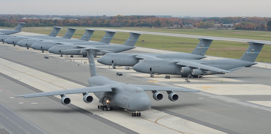 A C-5M Super Galaxy aircraft taxis with other C-5Ms in the background Nov. 2, 2015, at Dover Air Force Base, Del. Dover is home to the Air Forces' only isochronal maintenance facility for C-5 aircraft, some of which were experiencing smoke in the cockpit after completing ISO maintenance. Experts from Dover's 436th Maintenance Squadron created a low-cost piece of equipment that has fixed the problem and is in the process of being implemented Air Force-wide. (U.S. Air Force photo/Greg L. Davis)