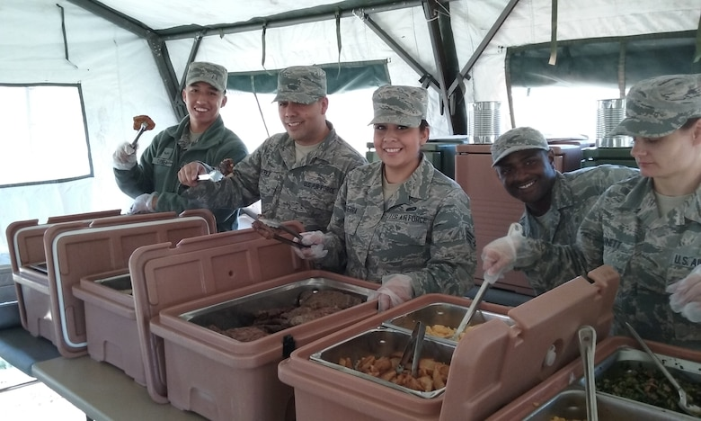 Airmen from the 507th Air Refueling Wing Force Support Squadron Services Sustainment Flight prepare to serve food during a field kitchen training exercise Nov. 7, 2015, at Tinker Air Force Base, Okla. The field kitchen is an Air Force requirement for use at remote and undeveloped sites.  (U.S. Air Force photo by Senior Airman Chelsea Thomas)