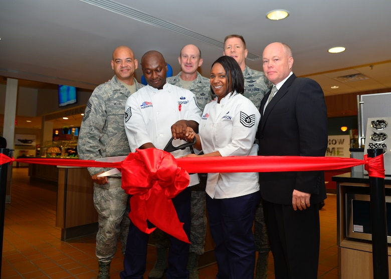 From left to right, back to front, Chief Master Sgt. Geraldo Moore, 436th Airlift Wing acting command chief; Col. Marc Piccolo, Air Force Services Activity commander; Col. Michael Grismer, 436th AW commander; Tech. Sgt. Mark Obeng Duro, 436th Force Support Squadron food service section chief; Tech. Sgt. Rhoneiula Johnson, 436th FSS dining facility manager and Brett Ladd, Sodexo senior vice president; cut the ribbon during the grand reopening of the Patterson Dining Facility Nov. 19, 2015, at Dover Air Force Base, Del. The dining facility underwent renovations and improvements from the Air Force Food Transformation Initiative to offer a wider variety of nutritional foods and beverages. (U.S. Air Force photo/Senior Airman William Johnson)