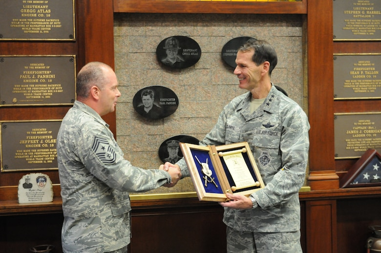 U.S. Air Force Lt. Gen. Stanley E. Clarke, III, director, Air National Guard, is presented the Order of the Sword invitation from Chief Master Sgt. James W. Hotaling, command chief master sergeant of the Air National Guard, at 10 House Fire Department, New York, N.Y., Nov. 11, 2015. The Air Force enlisted corps established the Order of the Sword to recognize and honor military senior officers for significant contributions to the enlisted force. (Air National Guard photo by Master Sgt. David Eichaker/released)