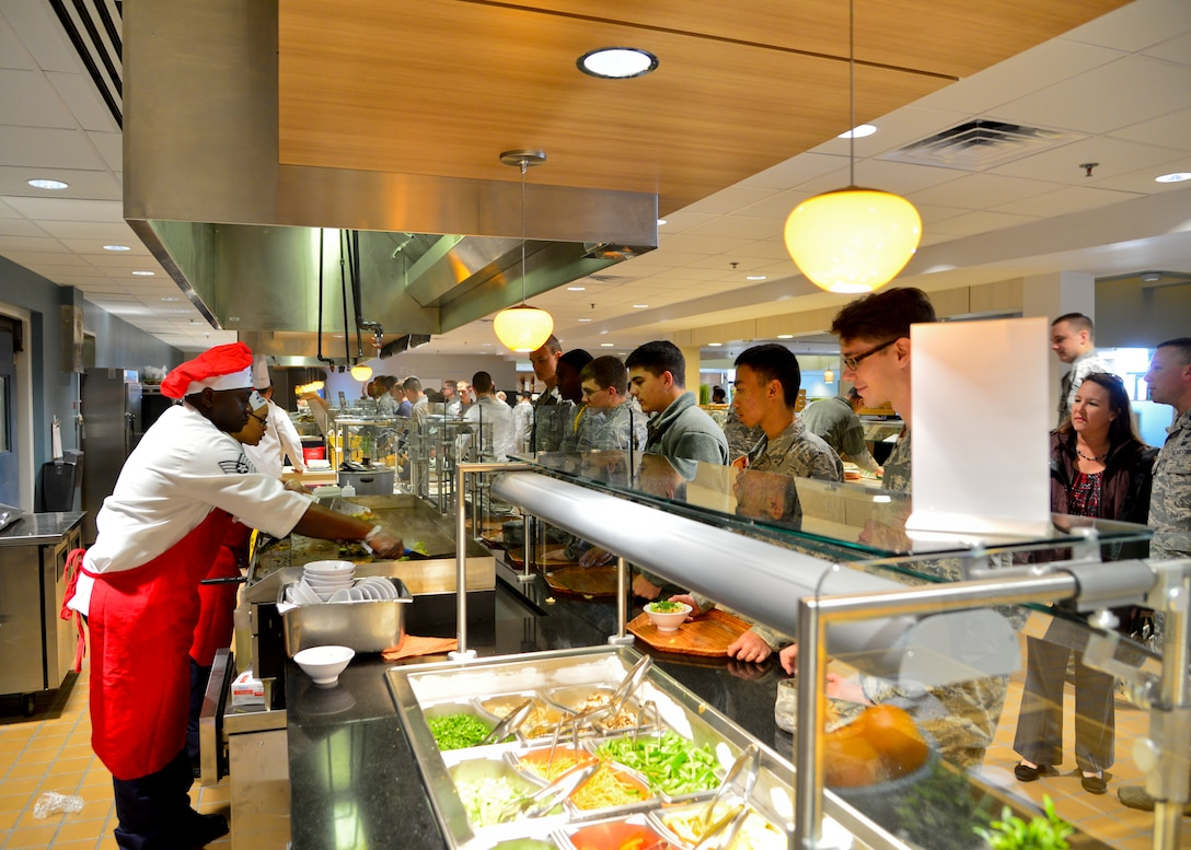 Tech. Sgt. Mark Obeng Duro, 436th Force Support Squadron food service section chief, and Staff Sgt. Jessica Williams, 436th FSS food service supervisor, operate the new Mongolian grill during the soft opening of the Patterson Dining Facility Nov. 17, 2015, at Dover Air Force Base, Del. The dining facility closed earlier this year to undergo improvements from the Air Force Food Transformation Initiative and now offers more, healthier options for dining customers. (U.S. Air Force photo/Senior Airman William Johnson)