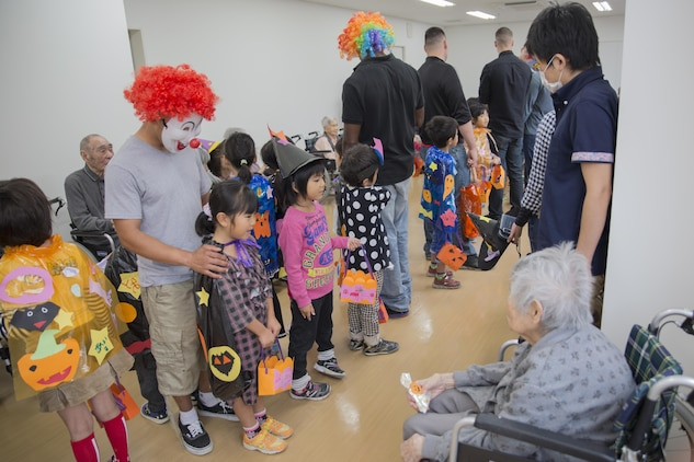 Service members from Marine Corps Air Station Iwakuni, Japan, and Japanese children from Ekimae Hoikuen Pre-school visited the Vita Nursing Home in Iwakuni City, Oct. 27, 2015. The community relations event, hosted by the Marine Memorial Chapel on the air station, gave service members the opportunity to interact with the Japanese youth and teach them about Halloween. The children also recited the American and Japanese alphabets with the senior citizens at the nursing home.