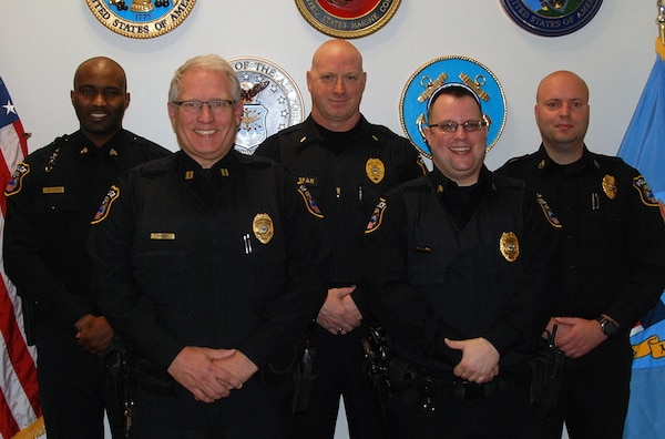 (From left) Defense Logistics Agency Police officers -- Sgt. William Epps; Capt. Gary Giseke; Lt. Mark Stefan; Sgt. Jason Carey and Staff Sgt. David Young -- used an automated external defibrillator to save the life of a DLA employee that was having a heart attack Nov. 2 at the McNamara Headquarters Complex.