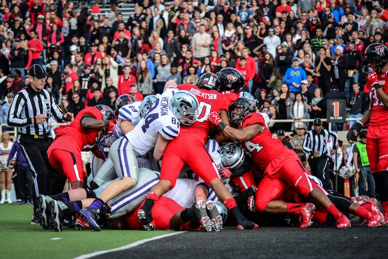 "Texas Tech defenders block a Kansas State touchdown attempt Nov. 14, 2015, in Lubbock, Texas. The TTU home game against Kansas State was their ""Celebrating America"" appreciation game, marking the school's gratitude and respect for military and first responders. (U.S. Air Force photo/Airman 1st Class Shelby Kay-Fantozzi)"