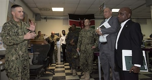 Ambassador Issimail Chanfi, director of the Eastern Africa Standby Force, receives an introduction to the Fusion Action Cell at Camp Lemonnier, Djibouti, Oct. 27, 2015. The FAC is comprised of service members from the U.S., Europe and East Africa working together to setup military-to-military projects and civilian support initiatives in partner countries throughout the Horn of Africa. U.S. Africa Command photo