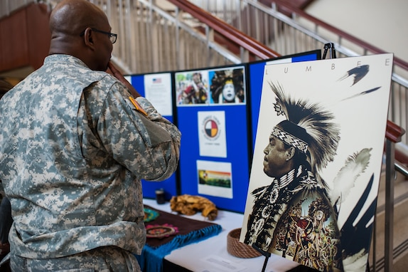 There were many displays and artifacts featuring Native American history during the U.S. Army Forces Command and U.S. Army Reserve Command National American Indian Heritage event, hosted by both command's Equal Opportunity directorates, at the U.S. Army Forces Command and U.S. Army Reserve Command headquarters, Nov. 18, 2015. The event also recognized three members of the Lumbee Tribe of North Carolina, the tribe's contributions to America and the nation's history. (U.S. Army photo by Timothy L. Hale/Released)